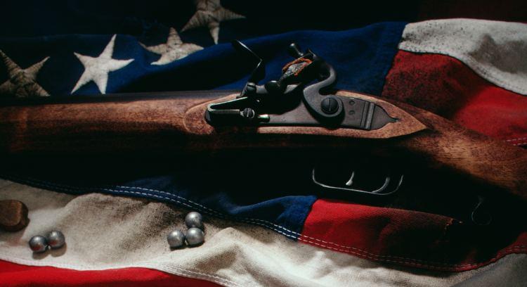 Gun and colonial flag
