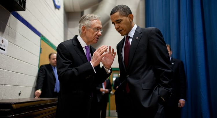 President Barack Obama talks with Senate Majority Leader Harry Reid (D-Nev.) backstage before his town hall meeting at Green Valley High School in Henderson, Nev., Feb. 19, 2010.  (Official White House Photo by Pete Souza)