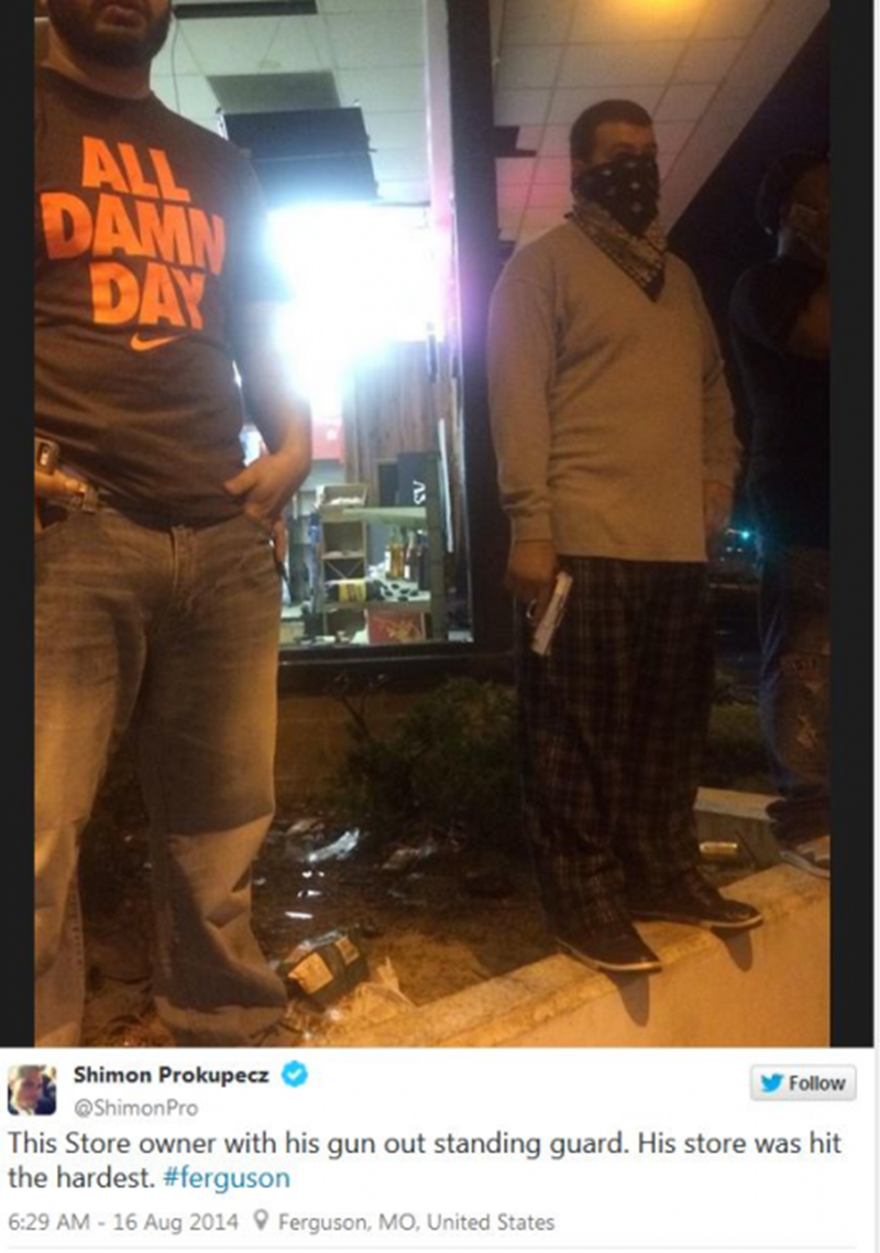 Pictures of Ferguson Business Owners Protecting Their Stores