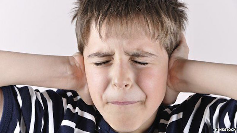 child hands over ears