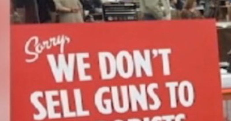 Gun Shop Owners Awesome Sign Equating Democrats Terrorists