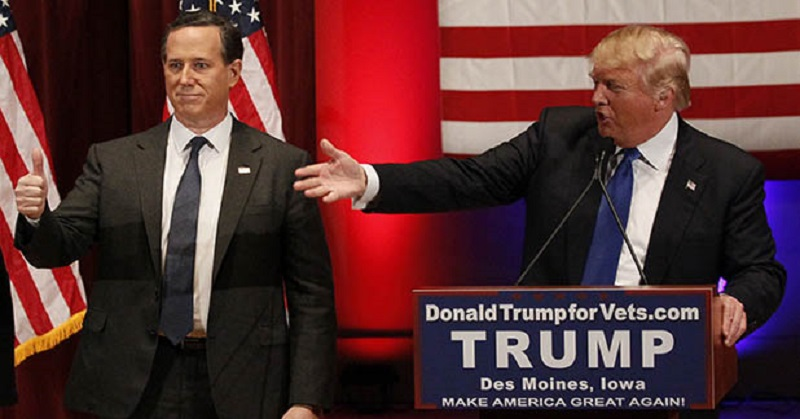 File photo of Republican U.S. presidential candidate Trump introducing Republican presidential candidate Santorum at his veteran's rally in Des Moines